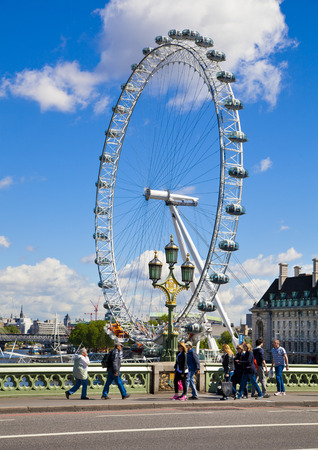 LONDON, UK - MAY 14, 2014  London eye is a giant Ferris wheel opened on 31 December 1999, the most famous tourist s attraction in centre London