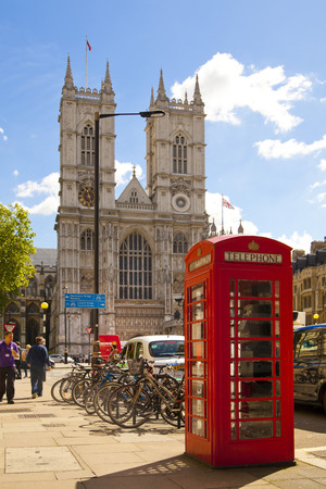 LONDON, UK - MAY 14, 2014  Westminster abbey and red telephone boz