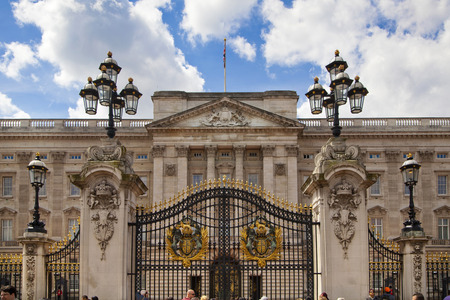 u k: LONDON, UK - MAY 14, 2014  Buckingham Palace the official residence of Queen Elizabeth II and one of the major tourist destinations U K  Entrance and main gate with lanterns