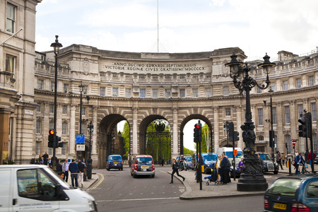 LONDON, UK - MAY 14, 2014   Admiralty Arch in London next to Trafalgar square, path leading pedestrian via The Mall to Buckingham palace