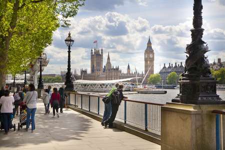 LONDON, UK - MAY 14, 2014 - Big Ben and Houses of Parliament on Thames river
