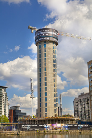 LONDON, UK - MAY 15, 2014   Building site with cranes in Canary Wharf aria  Raising new tallest residential tower in 43 floors in the business office aria Stock Photo - 29280309