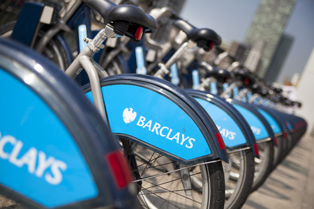LONDON, UK - MAY 7, 2014  Boris bikes parking on business Canary Wharf aria, sponsored by Barkley s bank  Popular city transport among Londoners