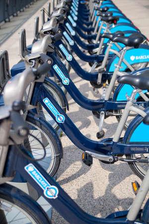 LONDON, UK - MAY 7, 2014  Boris bikes parking on business Canary Wharf aria, sponsored by Barkley s bank  Popular city transport among Londoners