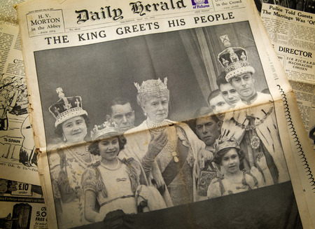 LONDON, UK - JUNE 16, 2014  King cheering his peopel, Royal family on front of Vintage English newspaper 13th of May, 1937 year
