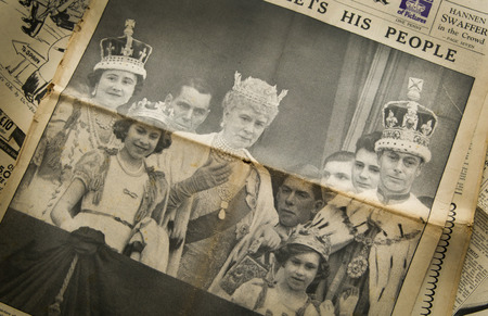 royal family: LONDON, UK - JUNE 16, 2014  King cheering his peopel, Royal family on front of Vintage English newspaper 13th of May, 1937 year