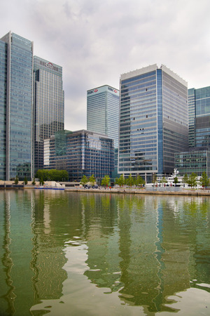 the other world: LONDON, CANARY WHARF UK - MAY 17, 2014  - Modern glass architecture of Canary Wharf business aria, headquarters for banks, insurance, media and other world known companies