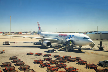 barajas: MADRID, SPAIN - MAY 28, 2014  Madrid airport, Aircraft gets to be ready to depart