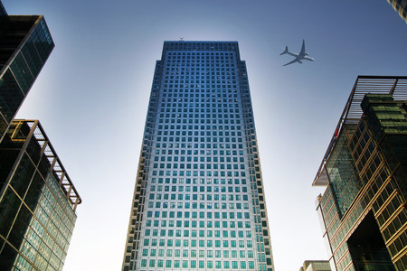 LONDON, UK - JUNE 30, 2014   Aircraft over the London s skyscrapers going to land in the City airport