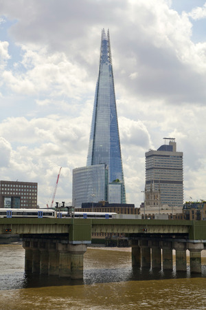 shard of glass: LONDON, UK - JUNE 30, 2014  Shard of glass on the river Thames, office and residential building in the City of London one of the leading centres of global finance  Editorial