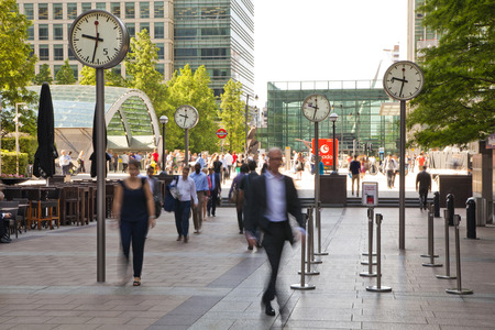 LONDON, UK - JULY 03, 2014  People blur  Office people moving fast to get to work at early morning in Canary Wharf aria
