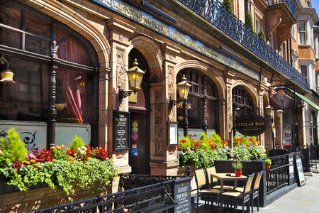LONDON, UK - JUNE 3, 2014  Luxury public house in Mayfair, decorated with flower baskets