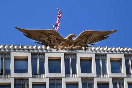election commission:  LONDON, UK - JUNE 3, 2014  Mayfair, USA embassy  Eagle the state symbol Editorial