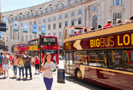 LONDON, UK - JUNE 3, 2014  Regent street, tourists and red double decker bus  regent street on of the main streets of London with lots of shops, stores and restaurants