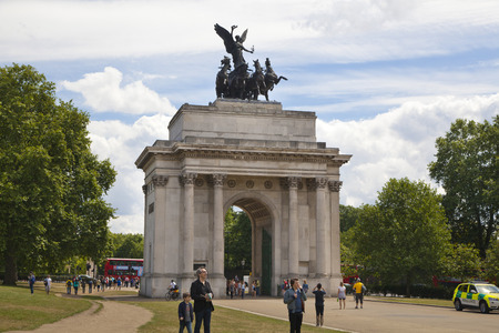 british touring car: LONDON, UK - JUNE 3, 2014  Mayfair, Triumph Wellington Arch in London