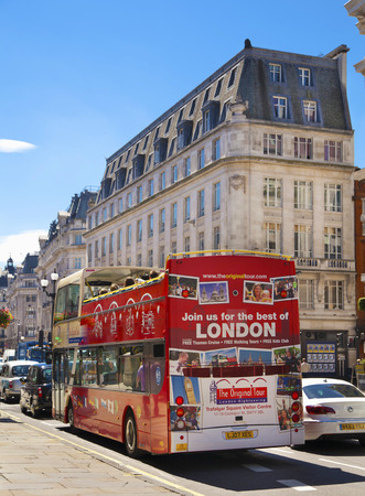 LONDON, UK - JUNE 3, 2014  Regent street in Mayfair, busy with tourists and public transport