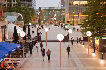 LONDON, UK - JULY 03, 2014  People blur  Office people passing square in the way to underground