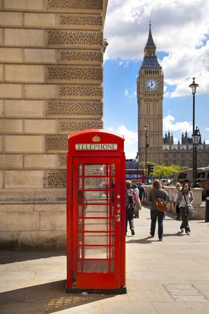 LONDON, UK - JUNE 24, 2014  Phone box in Westminster, red symbol of Great Britain
