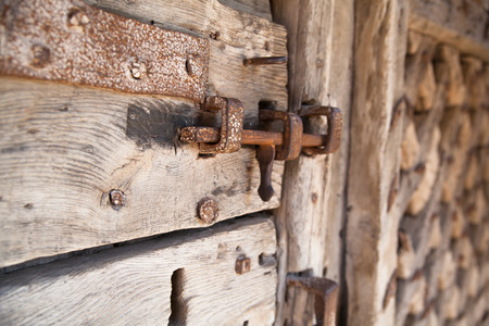 600 years old wooden doors with metal frame work and lock photo
