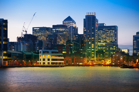 premises: LONDON, UK - JULY 29 2014  Canary Wharf business district in dusk Editorial