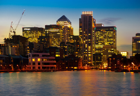 LONDON, UK - JULY 29 2014  Canary Wharf business district in dusk