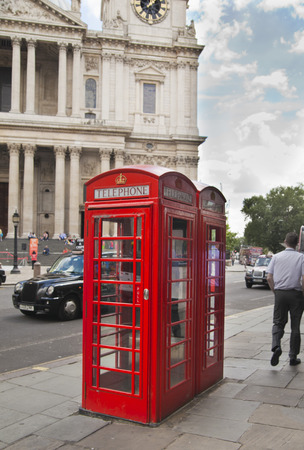 LONDON, UK - JULY 6, 2014   Red phone box and St  Paul s cathedral