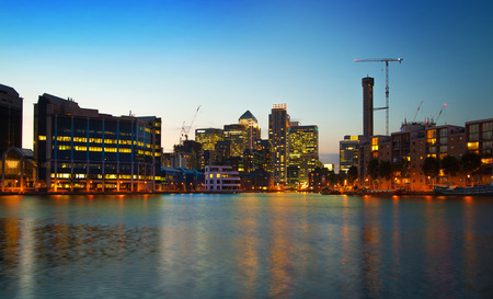 LONDON, UK - JUNE 14, 2014: Canary Wharf at dusk, Famous skyscrapers of London
