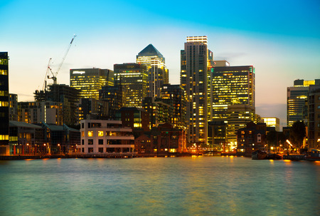 LONDON, UK - JUNE 14, 2014: Canary Wharf at dusk, Famous skyscrapers of London Editorial