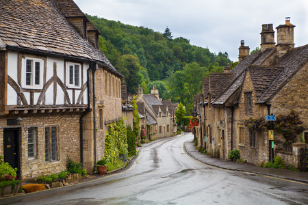 english famous: WILTSHIRE, CHIPPENHAM, UK - AUGUST 9, 2014: Castle Combe, unique old English village and luxury golf club