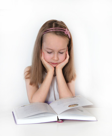 pre adolescent girl: Girl reading the book  education and school concept
