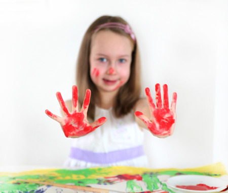 colour pencils: Girl drawing with water colours