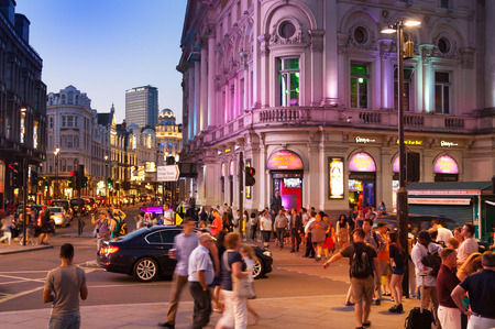 british touring car: LONDON, UK - AUGUST 22, 2014: Piccadilly Circus in night. Famous place for romantic dates. Square was built in 1819 to join of Regent Street Editorial