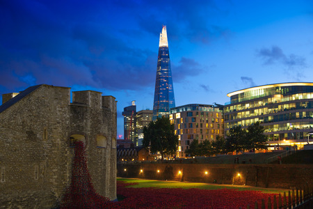 LONDON, UK - AUGUST 11, 2014: Shard of glass in night lights, view from the Tower bridge Editorial