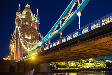Tower bridge on the river Thames in night lights photo