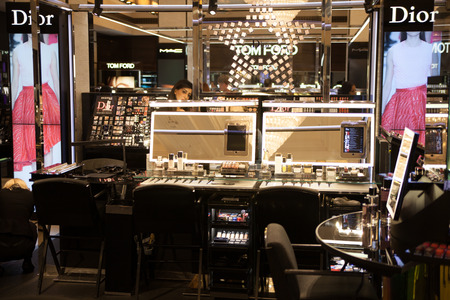 harrods: LONDON, UK - AUGUST 16, 2014: Harrods interiors with cosmetic  products display Editorial