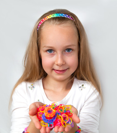 accessorize: Loom bags craft. Little girl demonstrating her works.