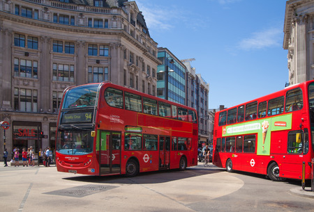 regent: LONDON, UK - JULY 29, 2014: Regent street in London, tourists and busses Editorial