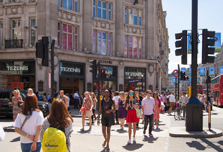 end of road: LONDON, UK - JULY 29, 2014: Regent street in London, tourists crossing the junction