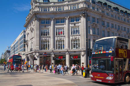 busses: LONDON, UK - JULY 29, 2014: Regent street in London, tourists and busses Editorial