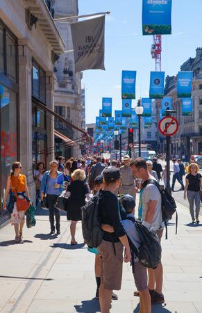 regent: LONDON, UK - JULY 29, 2014: Regent street in London, tourists