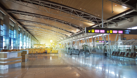 check in: MADRID, SPAIN - MAY 28, 2014: Interior of Madrid airport, departure waiting aria