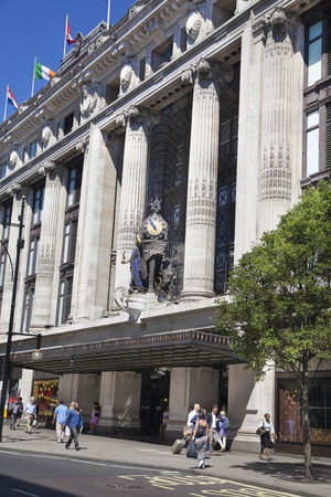 LONDON, UK - JULY 29, 2014: Regent street in London, tourists and buses