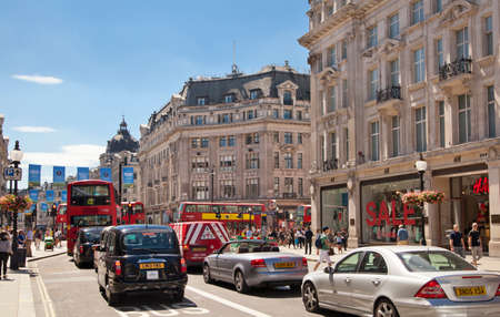 oxford street: LONDON, UK - JULY 29, 2014: Regent street in London, tourists and buses Editorial