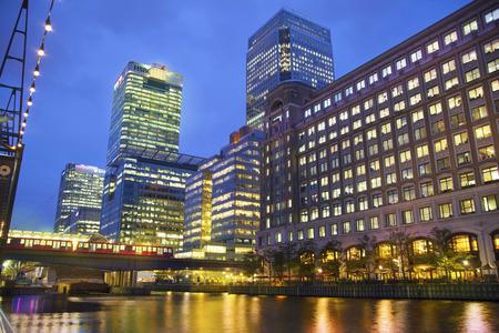 corporate buildings: LONDON, UK - JUNE 14, 2014: Canary Wharf at dusk, Famous skyscrapers of London\\\\\\\\