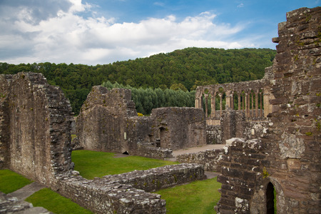 abbey ruins abbey: WALES, UK - 26 JULY 2014: Tintern abbey cathedral ruins. Abbey was established at 1131. Destroyed by Henry VIII. Famous as Welsh ruins from 17the century. Editorial