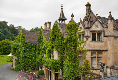 manor house: CHIPPENHAM, UK - AUGUST 9, 2014: Castle Combe, luxury house and gardens turned to be a hotel and golf club Editorial