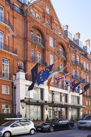 4 star: LONDON, UK - JUNE 3, 2014: International flags above the main entrance of luxury Claridges hotel