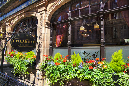 public house: LONDON, UK - JUNE 3, 2014: Luxury public house in Mayfair, decorated with flower baskets
