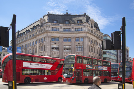 regent: LONDON, UK - JULY 29, 2014: Regent street in London, tourists and buses Editorial