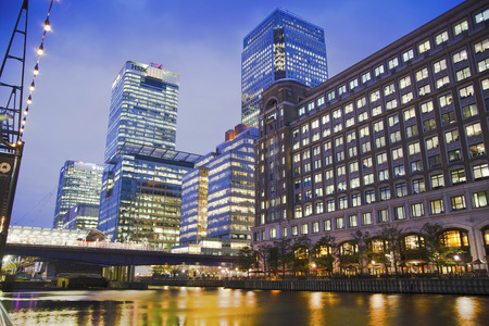LONDON, UK - JUNE 14, 2014: Canary Wharf at dusk, Famous skyscrapers of Londons financial district at twilight.